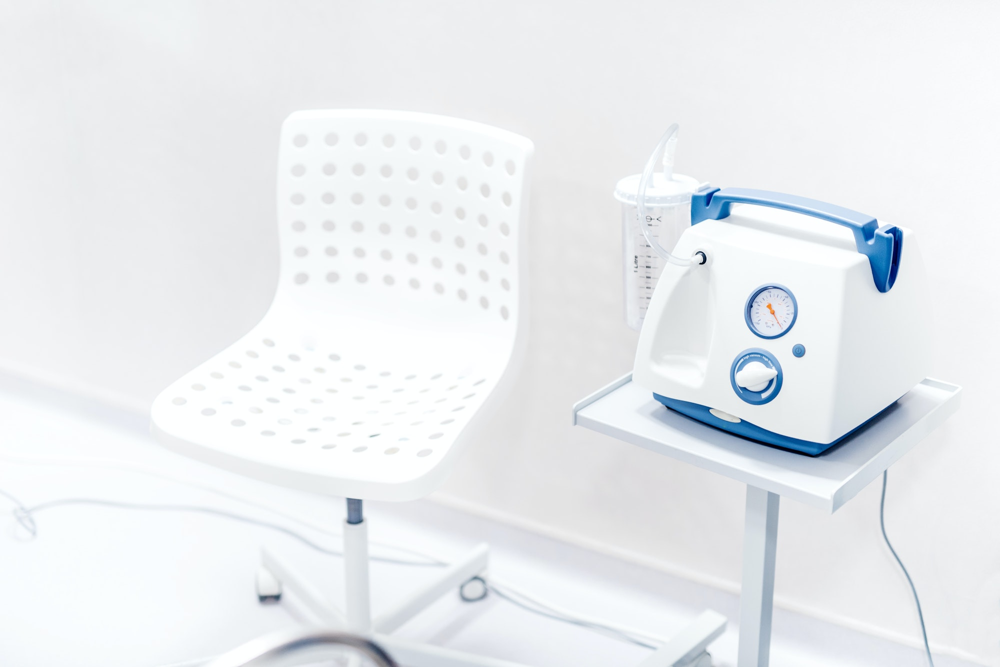 Chair and medical device in hospital room. Blood pressure and oxygen ventilation device