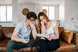 Couple with financial problems at home