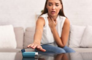 Girl Reaching For Asthma Inhaler Preventing Respiratory Depression At Home