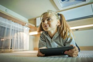 Girl with Tablet Inside RV