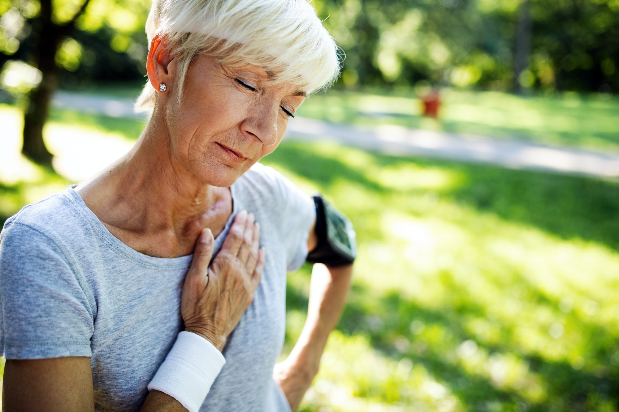 Mature woman exercising outdoors to prevent cardiovascular diseases and heart attack