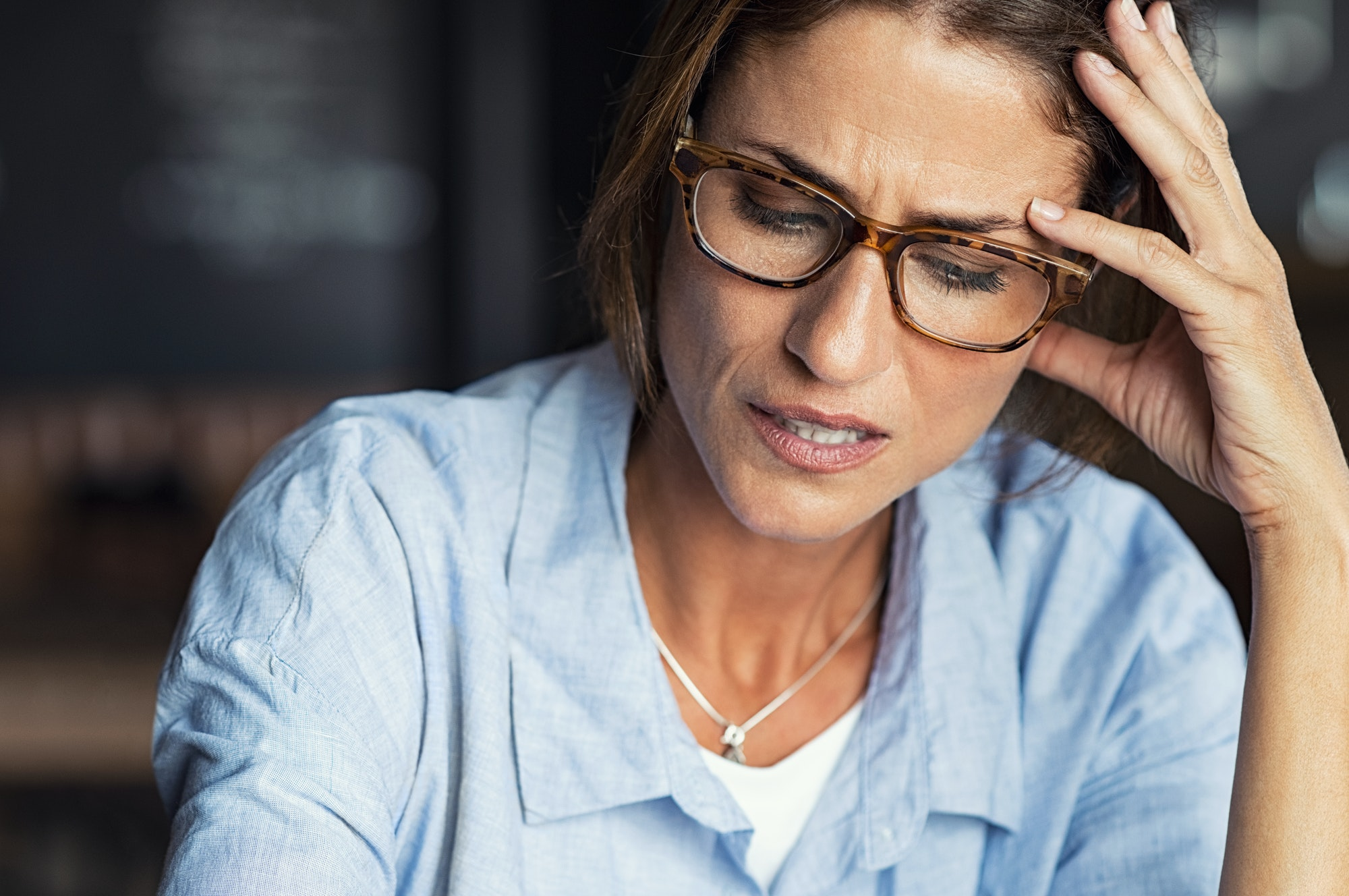 Stressed woman wearing eyeglasses