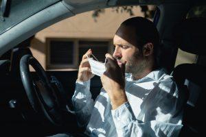 Caucasian man sitting in a car wearing a coronavirus covid19 mask