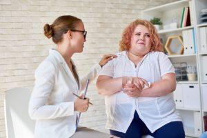 Female Psychiatrist Comforting Patient