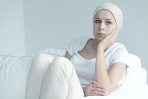 Woman with cancer sitting