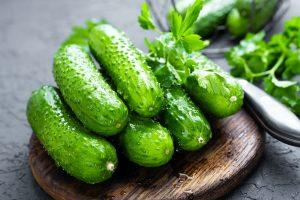 Cucumbers. Fresh cucumbers on wooden board