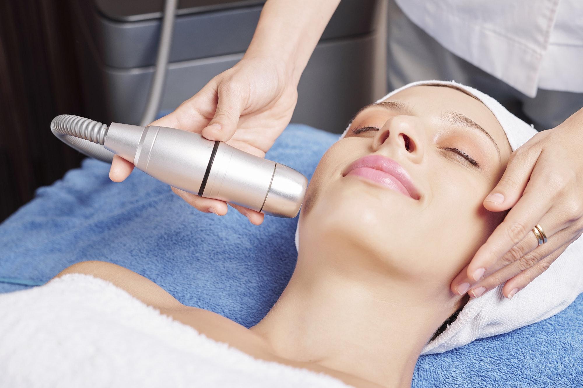 Removing dark spots at spa salon