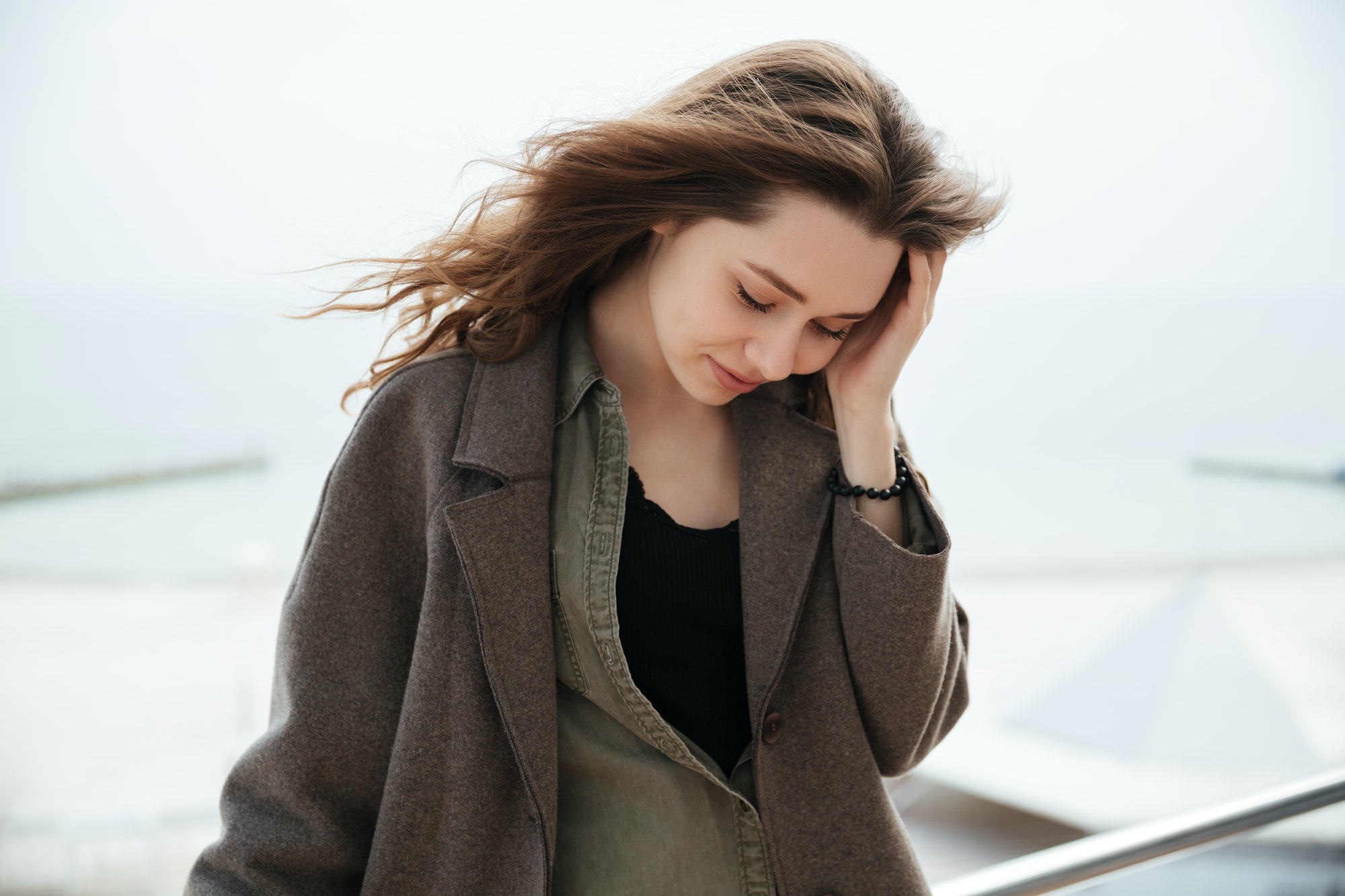 Tired woman near sea